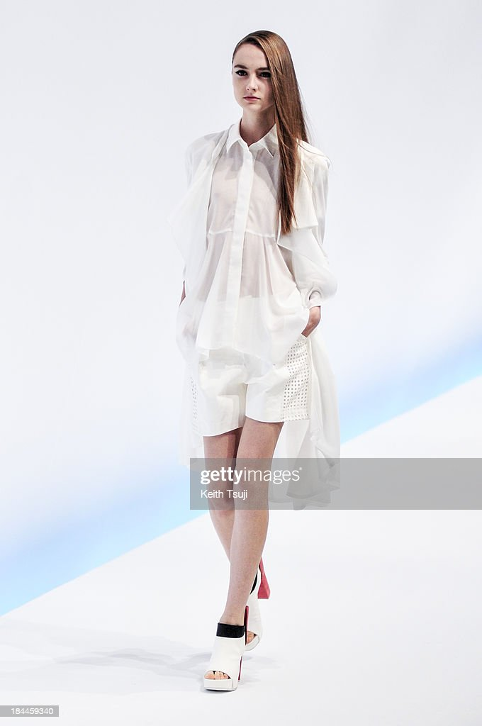 A model showcases designs on the runway during the Yasutoshi Ezumi show as part of Mercedes Benz Fashion Week Tokyo S/S 2014 at Hikarie Hall B of Shibuya Hikarie on October 14, 2013 in Tokyo, Japan.