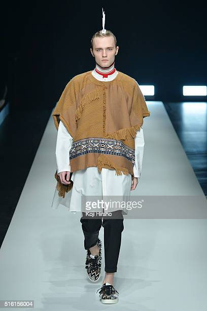A model showcases designs on the runway during the yoshio kubo show as a part of Mercedes Benz Fashion Week TOKYO A/W 2016/2017 at Shibuya Hikarie on...