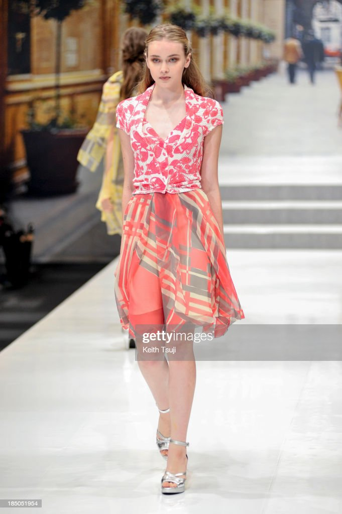 A model showcases designs on the runway during the YUKI TORII INTERNATIONAL show as part of Mercedes Benz Fashion Week Tokyo 2014 S/S at Laforet Museum Roppongi on October 17, 2013 in Tokyo, Japan.