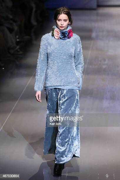A model showcases designs on the runway during the YUKI TORII show as part of Mercedes Benz Fashion Week TOKYO 2015 A/W at EBiS on March 20 2015 in...