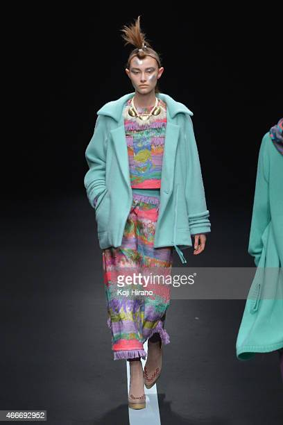 A model showcases designs on the runway during the YUMA KOSHINO show as part of Mercedes Benz Fashion Week TOKYO 2015 A/W at Shibuya Hikarie on March...
