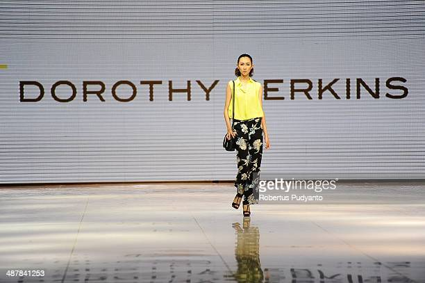 A model showcases Dorothy Perkins Collection on the runway during The 7th Surabaya Fashion Parade 'NIWASANA NUSANTARA 2014' day two at Tunjungan...
