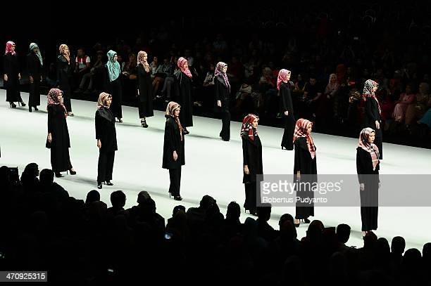 A model showcases Hijab designs by El Zatta on the runway during Indonesia Fashion Week 2014 day 2 at Jakarta Convention Center on February 21 2014...