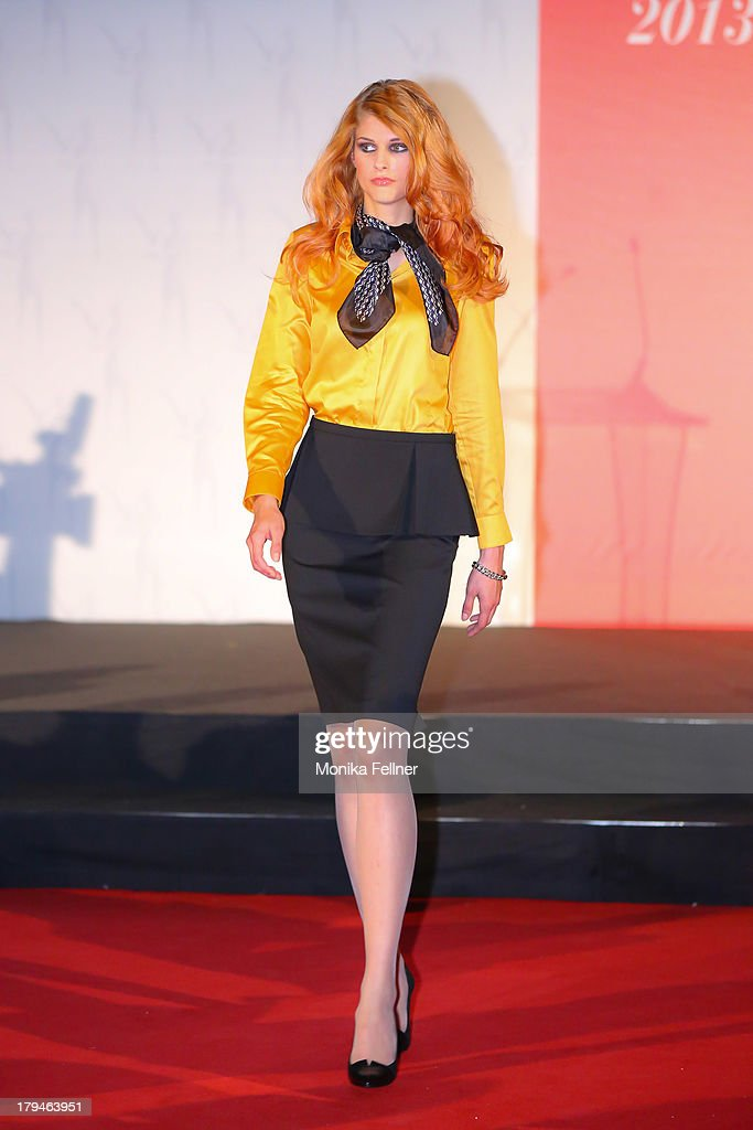 A model showcases Madeleine designs on the catwalk during the Leading Ladies Awards 2013 at Belvedere Palace on September 3, 2013 in Vienna, Austria.