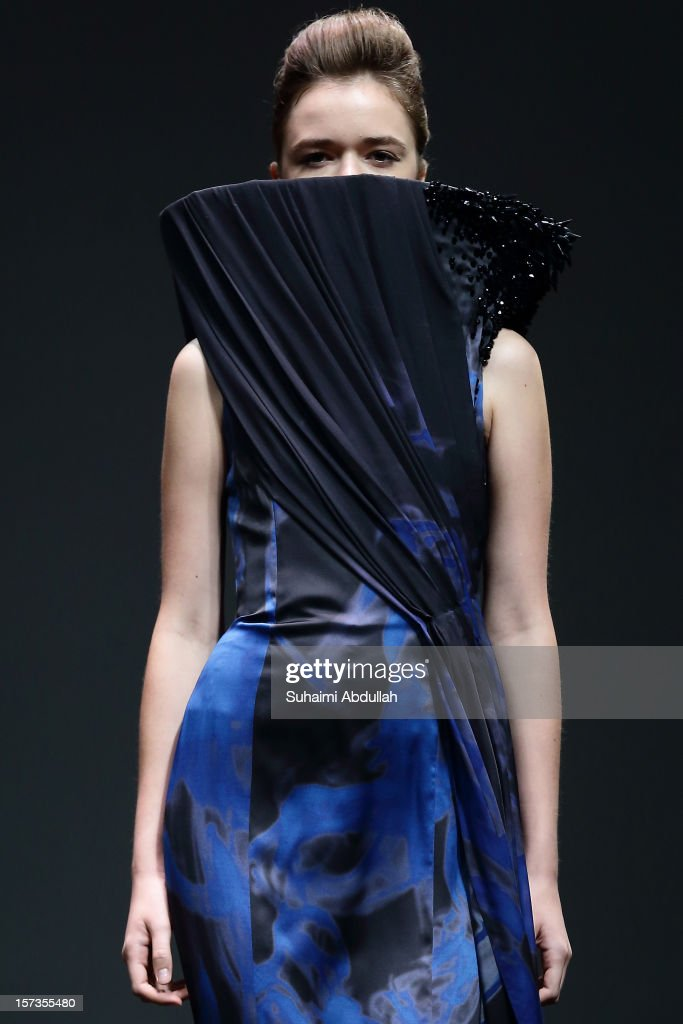 A model showcases On Aura Tout Vu designs by Livia Stoianova and Yassen Samouilov on closing day of French Couture Week 2012 Singapore at The Shoppes at Marina Bay Sands on December 2, 2012 in Singapore.