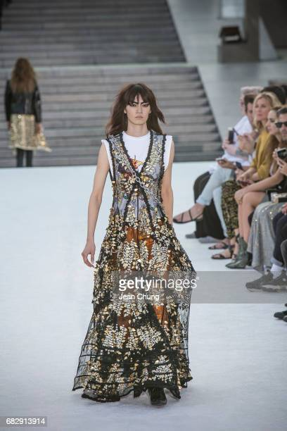 A model showcases the design on runway during the Louis Vuitton Resort 2018 show at the Miho Museum on May 14 2017 in Koka Japan
