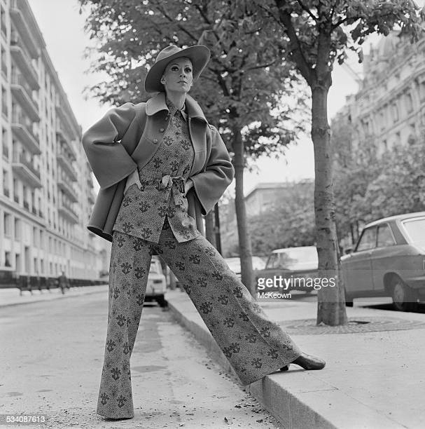 A model showing a rose printed suit and blue reefer jacket 9th April 1972