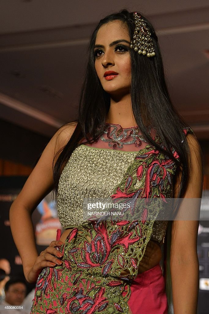 A model shows a creation by Indian designer Jattinn Kochhar and Sheetal Lyall during the fashion show Kingfisher Ultra Punjab Style Tour in Amritsar on August 2, 2014 . AFP PHOTO/NARINDER NANU