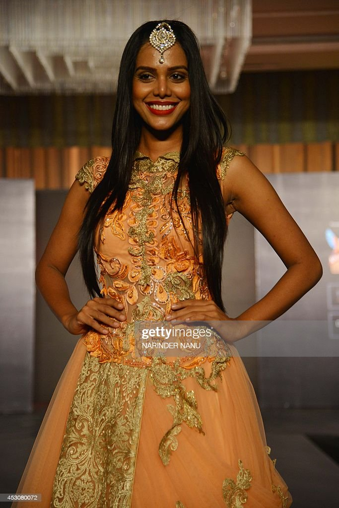 A model shows a creation by Indian designer Jattinn Kochhar and Sheetal Lyall during the fashion show Kingfisher Ultra Punjab Style Tour in Amritsar on August 2, 2014 .