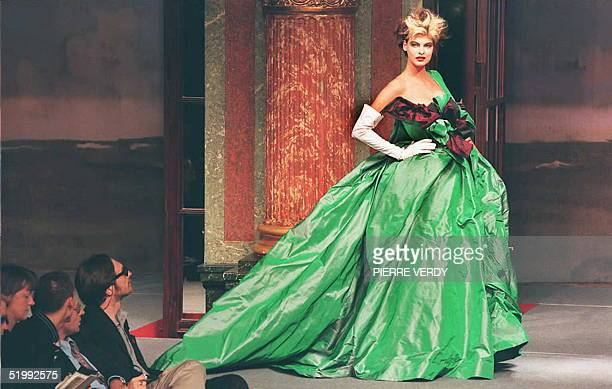 A model shows a Vivienne Westwood gown with a huge floral knot at the SpringSummer 1996 readytowear collection in Paris at the Grand Hotel 16 October...