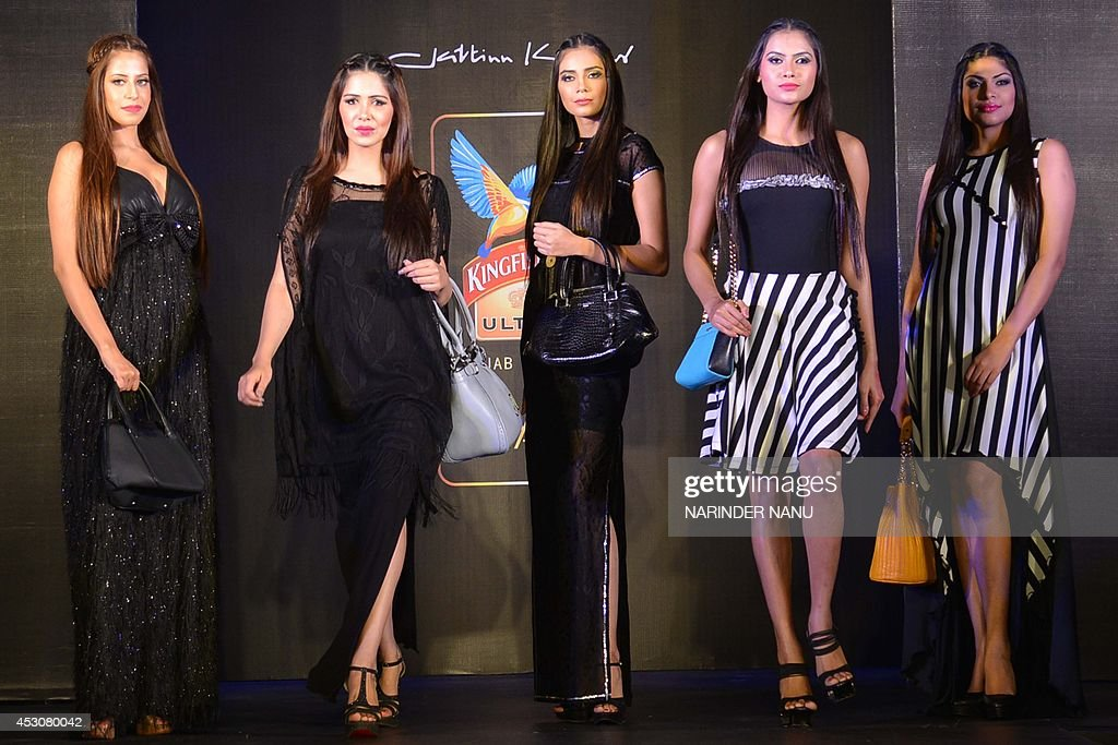 Model shows creations by Indian designer Jattinn Kochhar and Sheetal Lyall during the fashion show Kingfisher Ultra Punjab Style Tour in Amritsar on August 2, 2014 .