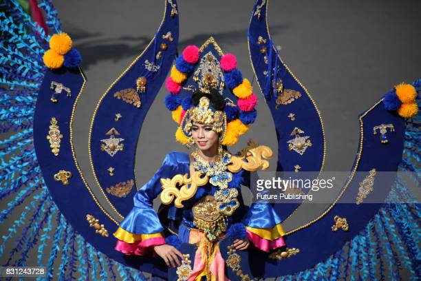 Model shows fashion creations during Grand Carnival as part of the 16th Jember Fashion Carnival on August 13 2017 in Jember East Java Indonesia The...