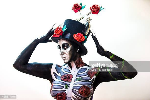 A model shows her body painted by art students of the Chilean institute AIEP during an exhibition of body painting during which they displayed more...