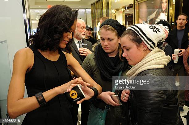 A model shows holiday shoppers william's iamPULS during black Friday at Bloomingdale's on November 28 2014 in New York City