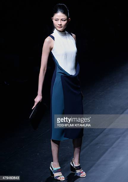A model shows off a creation by Indonesian fashion brand Major Minor's three designers Ari Septutra Ambar Pratwi and Inneke Margarethe during Tokyo...