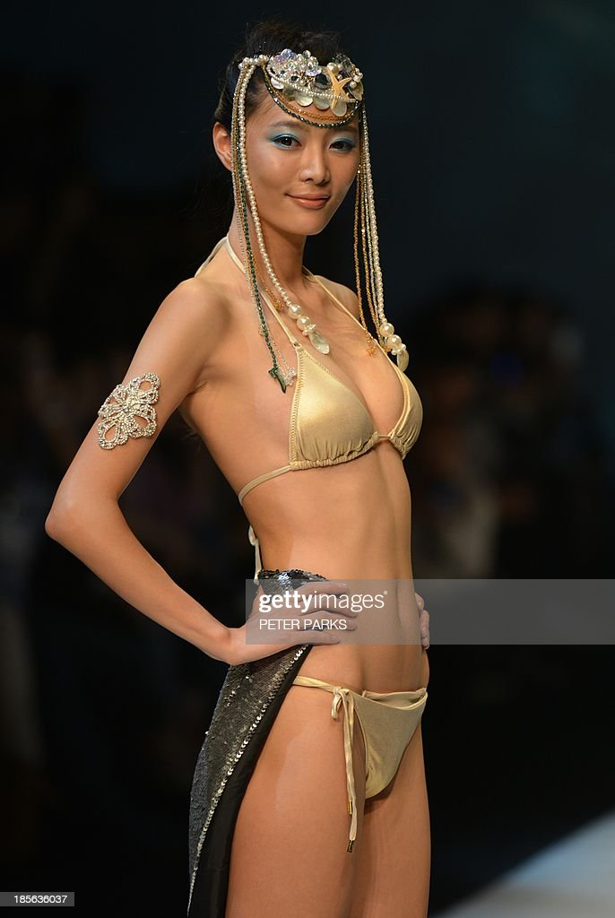 A model shows off a creation by Maryan Mehlhorn during the Shanghai Mode Lingerie Fashion show in Shanghai on October 23, 2013. The show is a part of Shanghai's bi-annual Fashion Week. AFP PHOTO/Peter PARKS