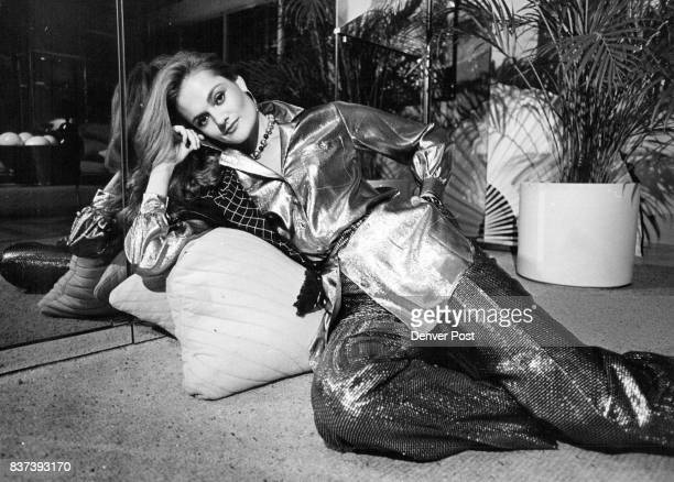 Model shows off Anne Klein gold lame belted shirt Blassport black and gold metallic pants as part of fall's glitter fashions at The Denver Credit...