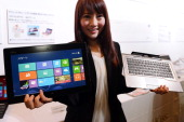 A model shows off Fujitsu's latest Windows 8 dualstyle PC 'FMV Stylistic QH77' during Fujitsu's Windows 8 PC press preview in Tokyo on October 19...