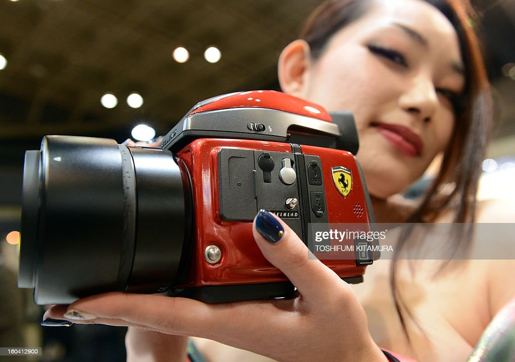 A model shows off Hasselblad H4D-40 Ferrari-limited-edition digital camera during the CP+, (CP plus) photo imaging show in Yokohama on January 31, 2013. Around 96 companies are participating in the exhibition with some 70,000 visitors expected in the four-day-long event. AFP PHOTO / TOSHIFUMI KITAMURA