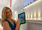 A model shows remote color and intensity control for Lightify mini garden spots at Osram stand in the Light Building 2014 Frankfurt Germany 29 March...
