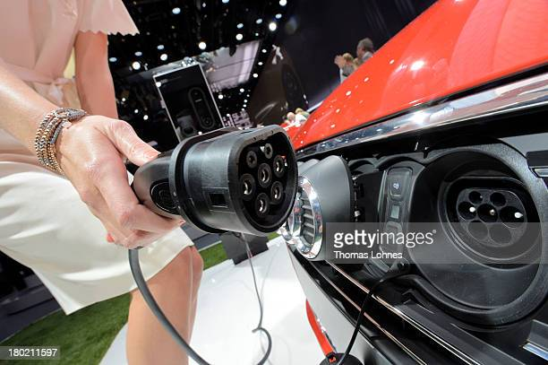 A model shows the plug connector of the new Audi A3 etron at the IAA international automobile show on September 10 2013 in Frankfurt Germany The...