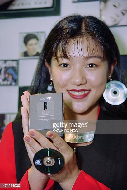 A model shows the world smallest portable player the MD walkman MZE2 produced by Sony on Ocotber 5 1993 at the Japan Electronic The disc player is 74...