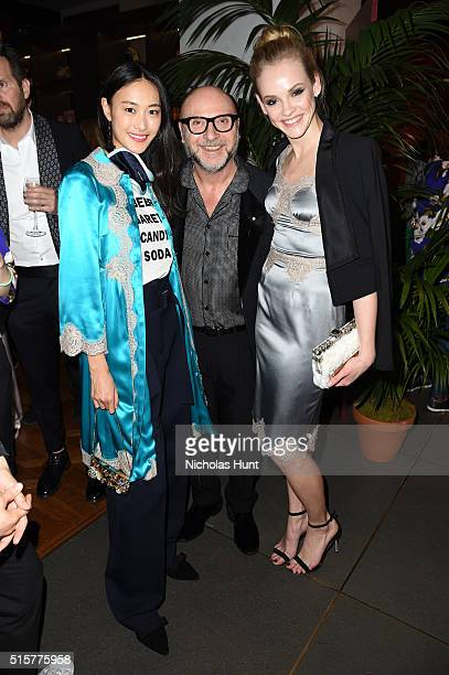 Model Shu Pei designer Domenico Dolce and model Ginta Lapina attend the Dolce Gabbana pyjama party at 5th Avenue Boutique on March 15 2016 in New...