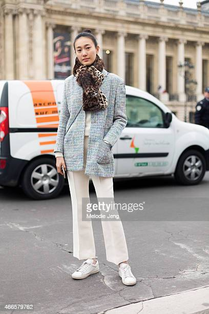 Model Shu Pei Qin wears Chanel after the Chanel show on Day 3 of Paris Haute Couture Fashion Week Spring/Summer 2015 on January 27 2015 in Paris...