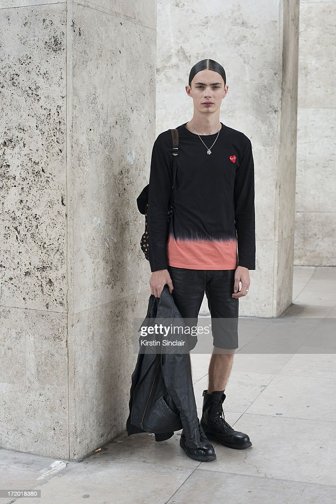 Model Simon Kotyk wears vintage shorts, a Comme des Garcons t shirt and boot from an Army and Navy store on day 3 of Paris Collections: Men on June 28, 2013 in Paris, France.