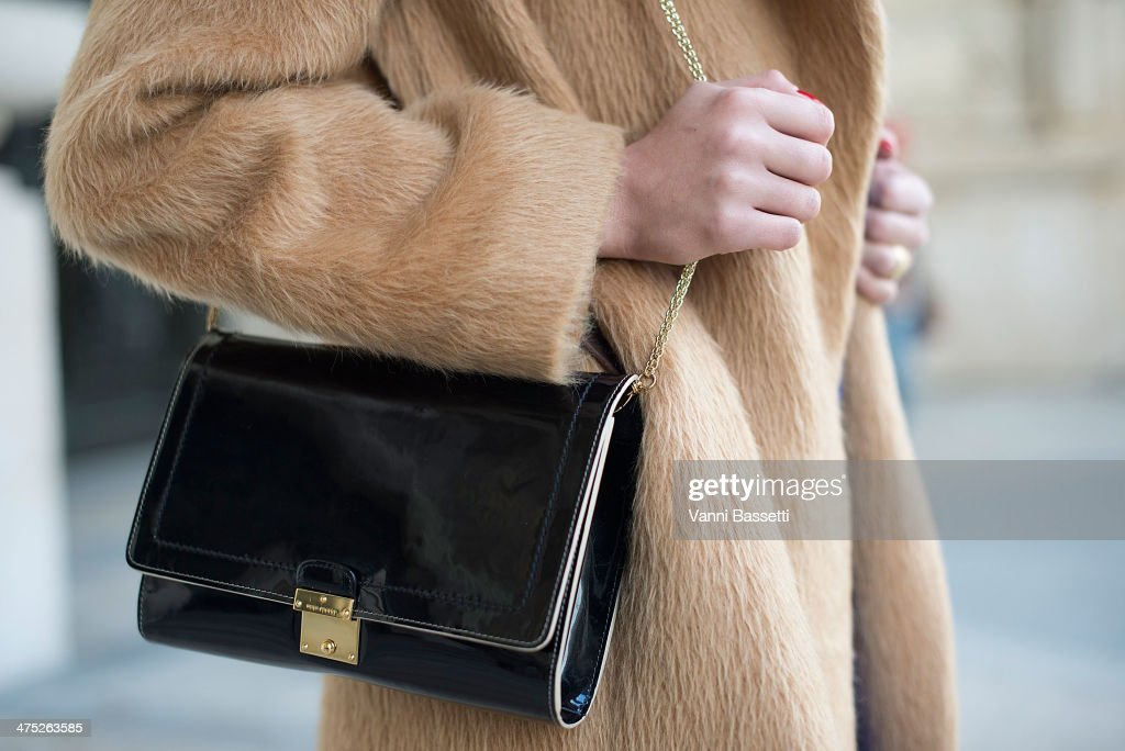 Model Simona Popovic poses wearing a Marc Jacobs coat and bag, before Guy Laroche show on Day 2 of Paris Collections Womenswear Fall/Winter 2014-2015 at the Grand Palais on February 26, 2014 in Paris, France.