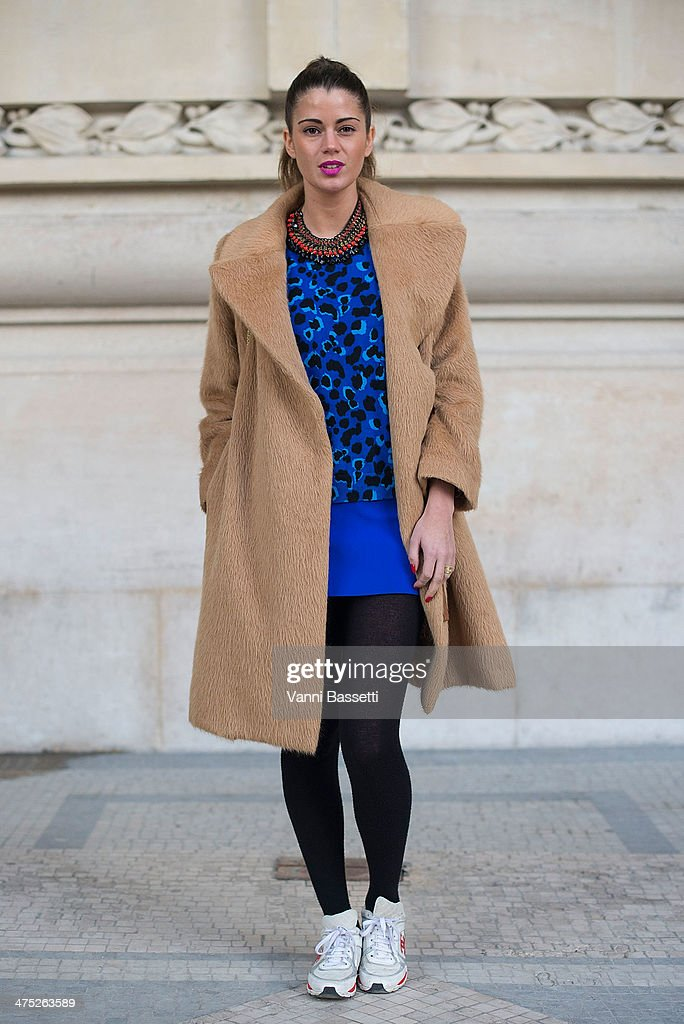 Model Simona Popovic poses wearing a Marc Jacobs coat and bag, Topshop dress and Chanel sneakers before Guy Laroche show on Day 2 of Paris Collections Womenswear Fall/Winter 2014-2015 at the Grand Palais on February 26, 2014 in Paris, France.