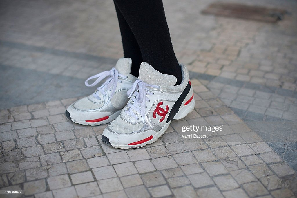 Model Simona Popovic poses wearing Chanel sneakers before Guy Laroche show on Day 2 of Paris Collections Womenswear Fall/Winter 2014-2015 at the Grand Palais on February 26, 2014 in Paris, France.