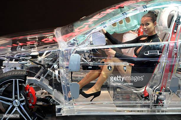 A model sits in a acrylic glass car body that shows the car technik at the IAA international automobile show on September 11 2013 in Frankfurt...