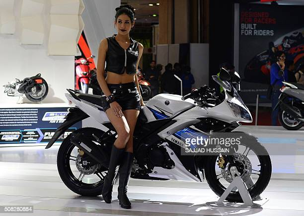 A model sits on a Yamaha R15S motorcycle at the Indian Auto Expo 2016 in Greater Noida some 45kms east of New Delhi on February 4 2016 India's...