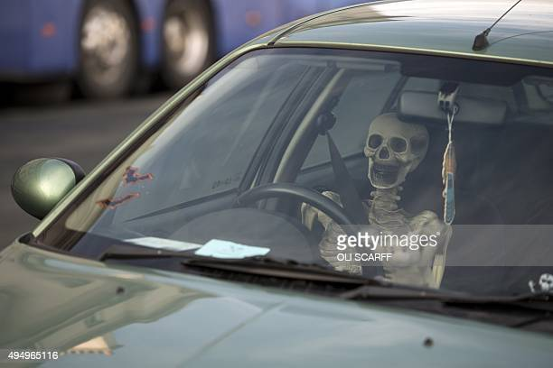 A model skeleton is placed in the driver's seat of a parked car during the biannual 'Whitby Goth Weekend' festival in Whitby northern England on...