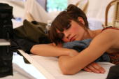 A model sleeps backsatge at the Multi By Bree Spring 2006 fashion show during Olympus Fashion Week at Bryant Park Grill on September 13 2005 in New...