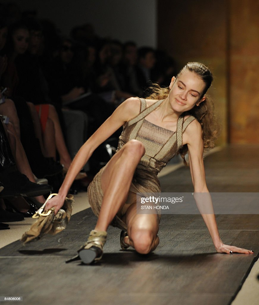 A model slips and falls during the Herve Leger by Max Azria show February 15, 2009 during the 2009 Mercedes Benz Fashion Week in New York. She recovered and was unhurt. AFP PHOTO/Stan Honda