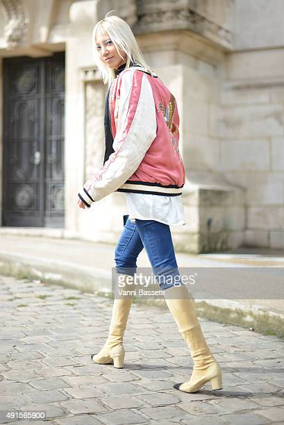Model Soo Joo Park leaves after the Chanel show at the Grand Palais during Paris Fashion Week SS16 on October 6 2015 in Paris France