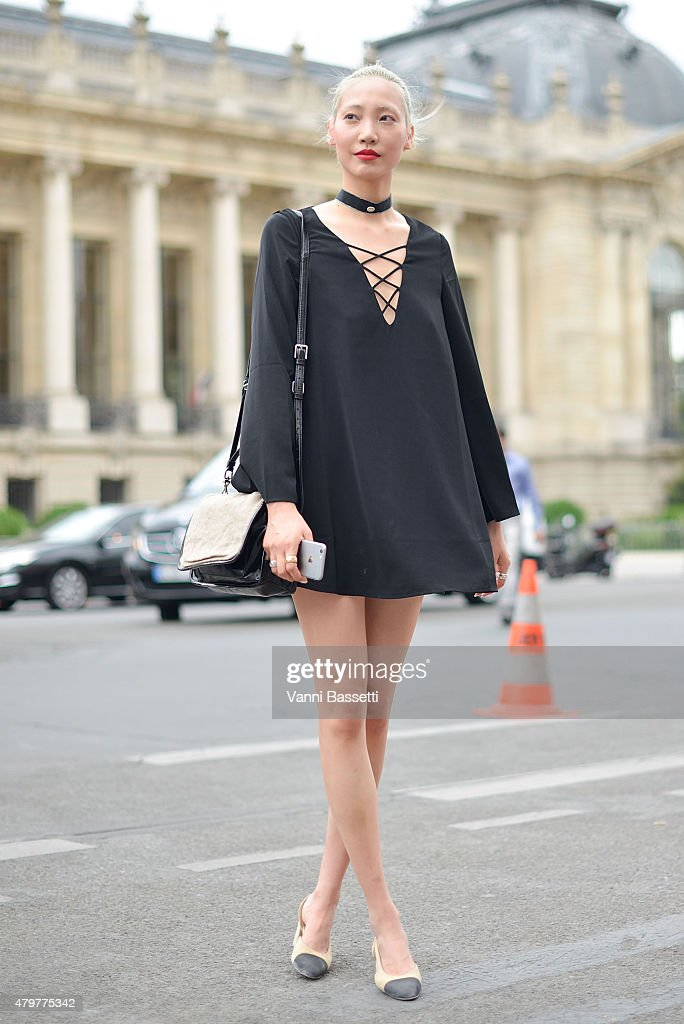 Model Soo Joo Park poses after the Chanel show at the Grand Palais on July 7 2015 in Paris France