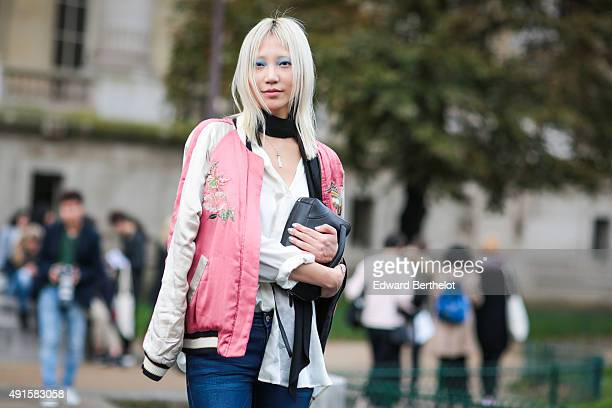Model Soo Joo Park wearing an Isabel Marant jacket after the Chanel show during Paris Fashion Week SS16 on October 6 2015 in Paris France