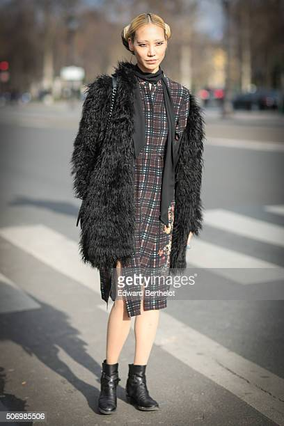 Model Soo Joo Park wearing Chanel after the Chanel show during Paris Fashion Week Haute Couture Spring Summer 2016 on January 26 2016 in Paris France