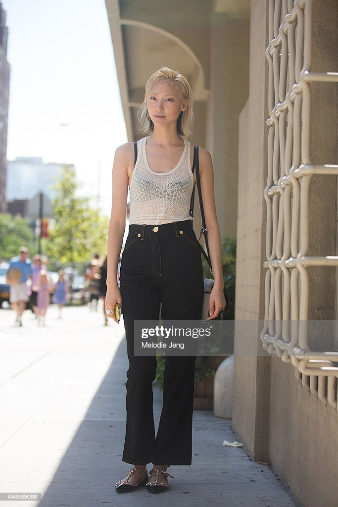 Model Soo Joo Park wears a Proenza Schouler top vintage Moschino pants Valentino flats and Bond Hardware rings after DKNY on Day 4 of New York...