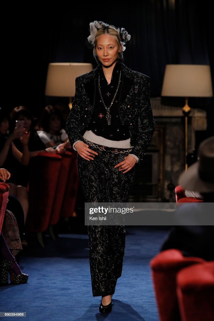 Model Soojoo showcases designs by CHANEL on the runway during the CHANEL Metiers D'art Collection Paris Cosmopolite show at the Tsunamachi Mitsui Club on May 31, 2017 in Tokyo, Japan.