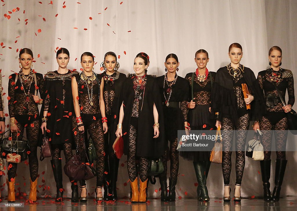 Model <a gi-track='captionPersonalityLinkClicked' href=/galleries/search?phrase=Sophie+Lowe&family=editorial&specificpeople=5921117 ng-click='$event.stopPropagation()'>Sophie Lowe</a> (C) showcases designs by MIMCO on the runway at the MIMCO show during L'Oreal Melbourne Fashion Festival on March 20, 2013 in Melbourne, Australia.