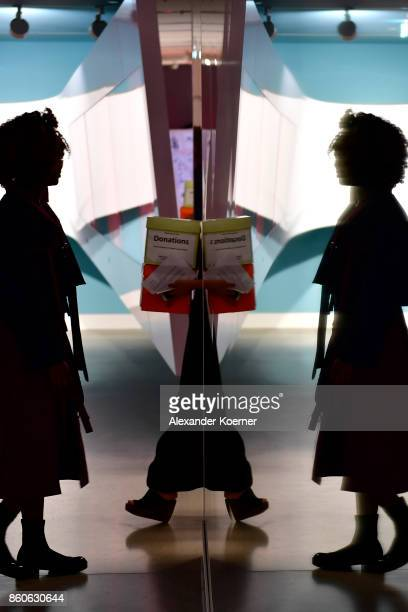 A model stands backstage prior the American Women's Club And Esmod Charity Fashion Show at DRIVE Volkswagen Group Forum on October 12 2017 in Berlin...