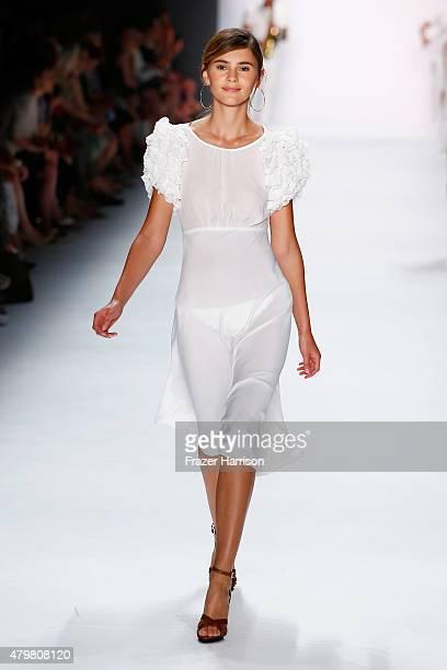 Model Stefanie Giesinger walks the runway at the Riani show during the MercedesBenz Fashion Week Berlin Spring/Summer 2016 at Brandenburg Gate on...