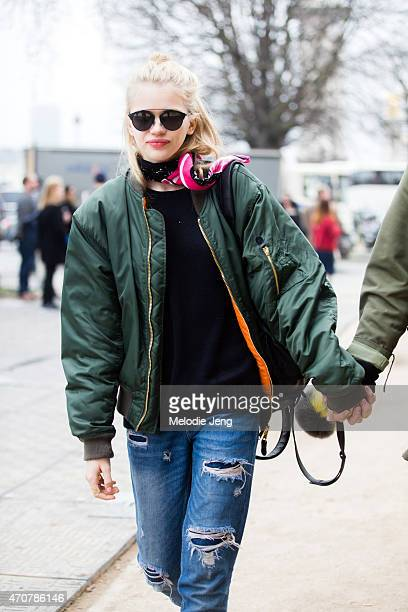 Model Stella Lucia exits the Chanel show at Grand Palais in a MA1 bomber jacket on Day 8 of Paris Fashion Week FW15 on March 10 2015 in Paris France