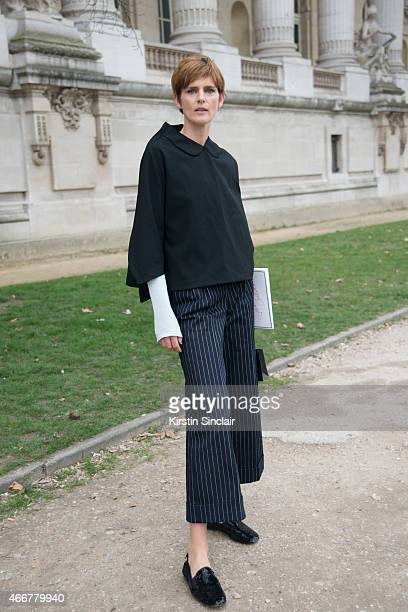 Model Stella Tenant wears all Chanel and a Comme De Garcons top on day 8 of Paris Collections Women on March 10 2015 in Paris France