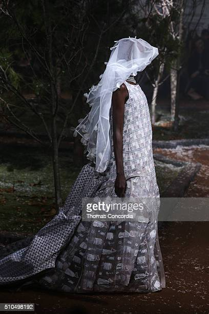 A model strolls through the park created by Thom Browne during his Fall 2016 Runway Presentation on February 15 2016 in New York City