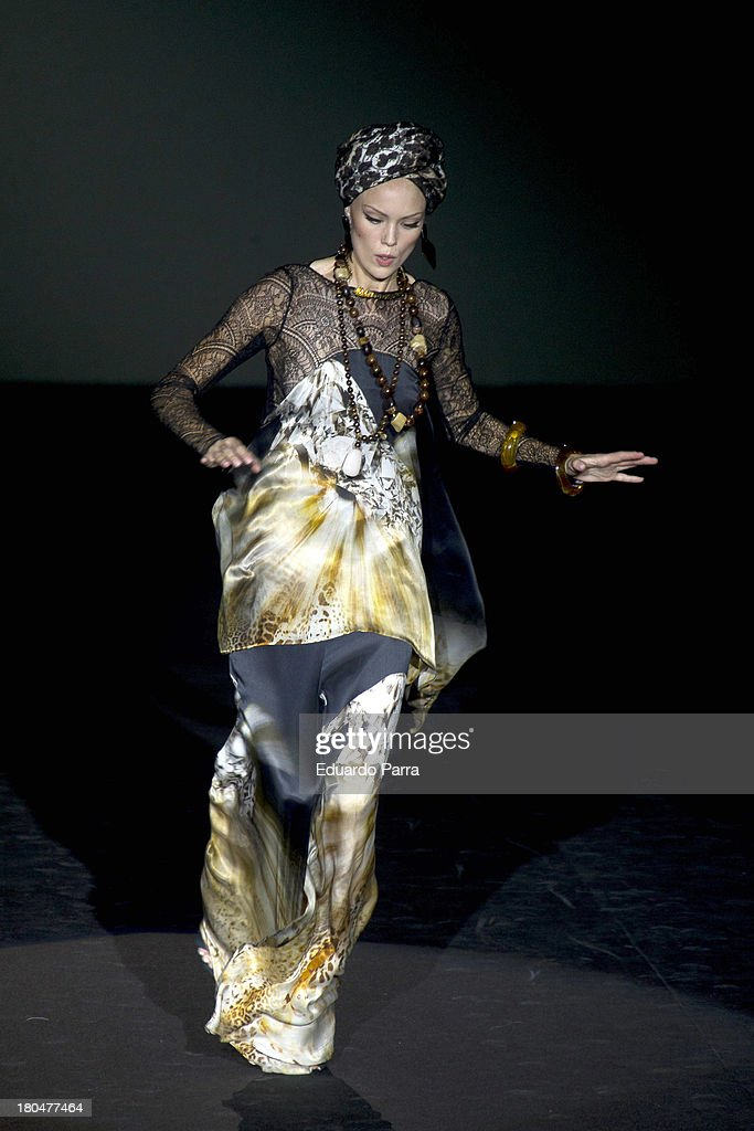 A model stumbles on the runway at Roberto Verino show during Mercedes Benz Fashion Week Madrid Spring/Summer 2014 at Ifema on September 13, 2013 in Madrid, Spain.